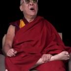 The Dalai Lama yawns during a cultural program at the Rigon Thupten Mindrolling monastery in Jeerang, India.  (AP Photo/Anupam Nath)