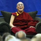 The Dalai Lama laughs as he speaks to students, faculty, and guests at Florida Atlantic University in Boca Raton, Florida.  (AP Photo/Alan Diaz)