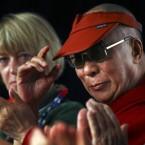 The Dalai Lama, right, U.S. Nobel Peace laureate Jody Williams, left, and others react during the first session at the 11th World Summit of Nobel Peace Laureates in Hiroshima, western Japan in November 2010.   (AP Photo/Junji Kurokawa)