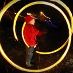 A long exposure photo shows a child spinning a ball of fire to ward off evil spirits during Bulgaria's Shrovetide festival. Pic: AP Photo/Valentina Petrova.