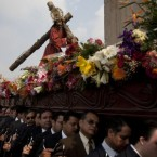 Catholics carry an image of Jesus Christ during a Holy Week procession in Guatemala City. Image: AP Photo/Moises Castillo.