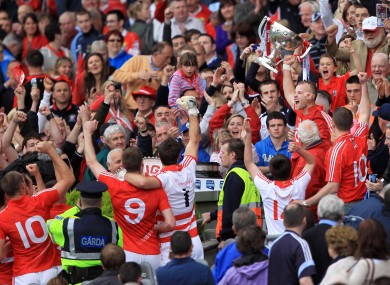 Cork captain Michael Shields lifts the Allianz Football League Division 1 trophy after victory over Dublin at Croke Park today.