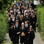 Seve Ballesteros' brother, Vicente, front center, holds the urn in honor of Spanish professional golfer Seve Ballesteros, during his funeral service in the small town of Pedrena, Spain today.<span class=