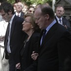Former Finance Minister Brian Lenihan's mother Ann is supported by son Conor as they arrive at St Mochta's Church in Porterstown, Dublin to attend his funeral. (Niall Carson/PA Wire)