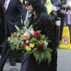 Floral tributes are brought into St Mochta's Church in Porterstown, Dublin for the funeral of former Finance Minister Brian Lenihan. (Niall Carson/PA Wire)