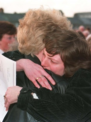 Shirley Wilson (right) comforts her friend Shirley Norris, whose father was one of the victims of the Kingsmills shootings, at a 20-year anniversary service in 1996.
