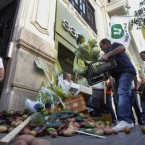 Protesting farmers dump some 300 kilos of fruit and vegetables outside the German consulate in Valencia, Spain on 2 June 2, 2011. (AP Photo/Robert Solsona)