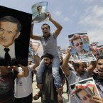 Pro-Syrian regime supporters carry pictures of President Bashar Assad and his father Hafez Assad, during a demonstration to show their support for the Syrian President, in Beirut, Lebanon, on 3 June, 2011. (AP Photo/Bilal Hussein)