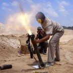 Rebel fighters fire their mortars towards pro-Gaddafi forces in Misrata, Libya (AP Photo)