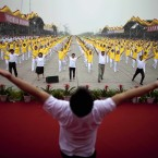 Hundreds of people take part in a synchronized mass exercise in Beijing (AP Photo/Alexander F. Yuan)