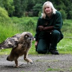 Gloria, an 11 week-old eagle owl chick, takes her first few steps outside her enclosure at Blair Drummond Safari Park near Stirling, Scotland (Andrew Milligan/PA Wire)