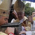 A priest kisses the relics of Pope John Paul II in Kiev, Ukraine (AP Photo/Sergei Chuzavkov)