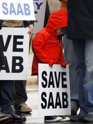 Jesper Hjertstedt, 4, of Milwaukee, Wisconsin, holds a sign during save Saab rally in Illinois in January 2010.