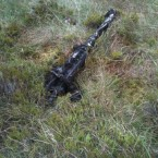 The first of the Browning machine guns emerges