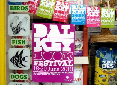 A poster for last year's festival hangs in a shop window
