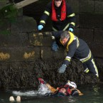 An unknown man is rescued after falling into the river Liffey in Dublin city centre in 2008.