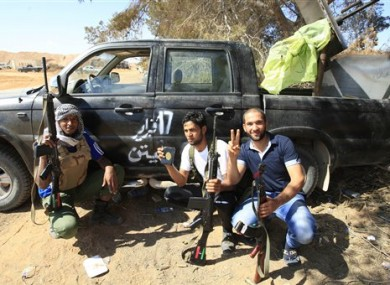 Rebels rest after clashes with pro-Gadaffi forces.