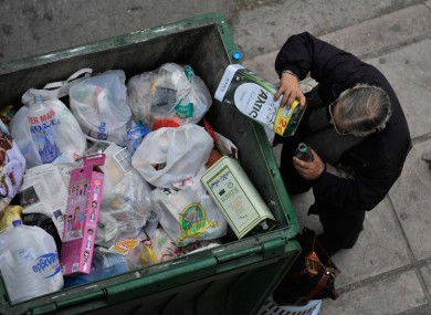 A dumpster in Greece filled with junk like the country's credit rating.