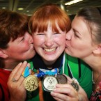 Team Ireland bowler Joyce Haughian from Warrenpoint Co.Down, with her three medals, is greeted by her mother Catherine (left) and sister Fiona (right).