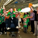 Friends and family of Team Ireland Special Olympic double medal winning kayaker Ruairi O'Toole (centre) welcome him home at Dublin Airport.