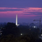 The sun sets behind the Washington Monument as seen from the US Capitol as negotiations over America's debt levels continue. (AP Photo/Harry Hamburg)