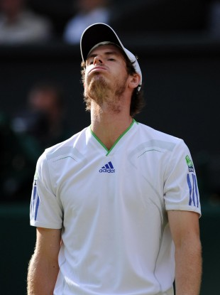Andy Murray appears dejected in his match against Spain's Rafael Nadal during day eleven of the 2011 Wimbledon Championships