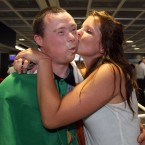 Ruairi O'Toole gets a kiss from Amy Frost.