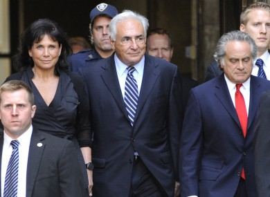 Strauss-Kahn leaving court last week with his wife Anne Sinclair (left)