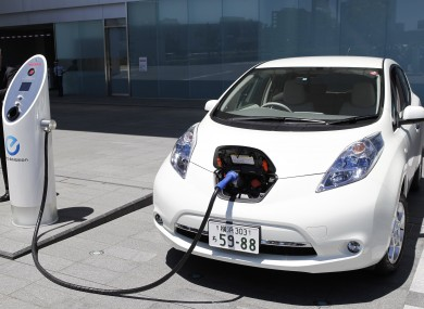 Nissan S Chief Engineer Hidetoshi Kadota Demonstrates How A Leaf Electric Car Is Recharged The