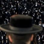 Ultra-Orthodox Jews attend a prayer in the religious neighborhood of Mea Shearim, Jerusalem (AP Photo/Bernat Armangue)