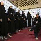 Saleswoman Sedigheh Heidari waits for customers to buy her chadors at the Imam Khomeini grand mosque in Tehran, Iran (AP Photo/Vahid Salemi)