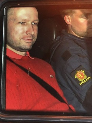 Anders Behring Breivik, left, sits in an armored police vehicle after leaving the courthouse following a hearing in Oslo.