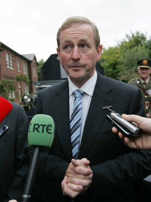 Taoiseach Enda Kenny answers questions about the Vatican response to the Cloyne report at the Curragh, in Co Kildare today.