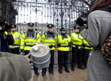 A protestor bangs a tin cup outside Leinster House on Budget Day last year