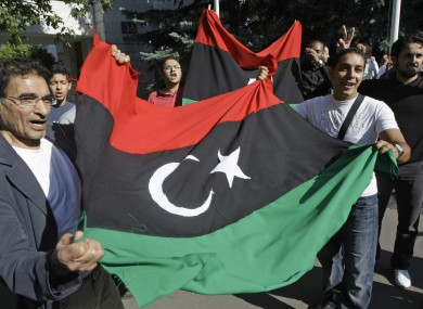 Libyans outside the country's embassy in Moscow, Russia which has now recognised the NTC.