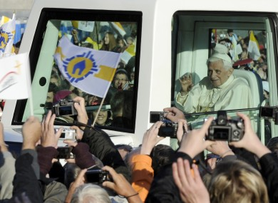 Pope Benedict XVI arrives in his popemobile to celebrate an open air mass in front of the St Mary's cathedral in Erfurt, central Germany, today.