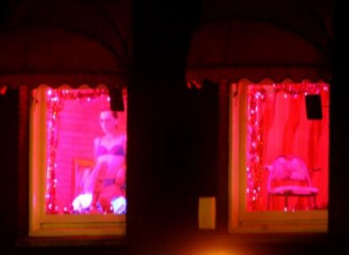 A prostitute in Amsterdam's 'red light district'
