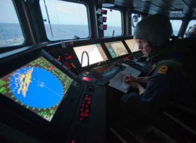 File photo of bridge crew on the Swedish warship HMSwMS Carlskrona coordinating shipping escorts and looking out for pirates off the Somali coast.