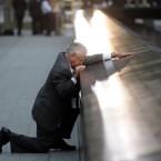 Robert Peraza, who lost his son Robert David Peraza in the attacks at the World Trade Center, pauses at his son's name at the North Pool of the memorial.   (AP Photo/Justin Lane, Pool)