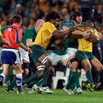 Stephen Ferris lifts Will Genia and drives him backwards.<span class=