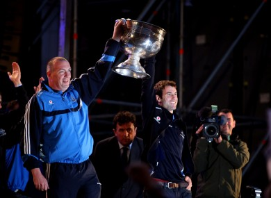 Dublin manager Pat Gilroy and captain Bryan Cullen carry out the Sam Maguire cup on stage.