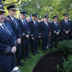 Airline pilots from United and American Airlines stand vigil at a memorial to Massachusetts victims of 9/11 during a ceremony in Boston. 