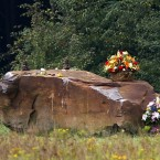 Friends and family of passengers and crew on United Flight 93 gather at a boulder with marks the site of the the crash of Flight 93 in Shanksville. (AP Photo/Amy Sancetta)