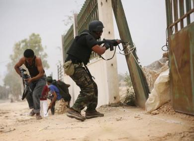 Rebel fighters in Sirte yesterday