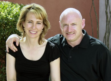 Giffords and her husband Mark Kelly pictured prior to the shooting in January (File photo)
