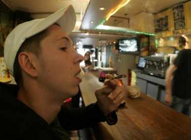 A coffee shop customer smoking a joint