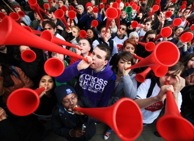 Supporters of Stop Climate Chaos blowing vuvuzelas outside the Dail today to express their frustration at the slow pace of political action to combat climate change