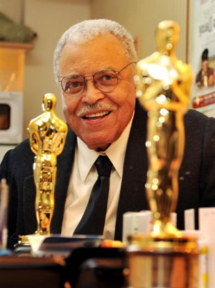 James Earl Jones the veteran American actor with his lifetime achievement Oscar, seen relected in a mirror in his dressing room at the Wyndham's Theatre where he is starring in Driving Miss Daisy, in central London.