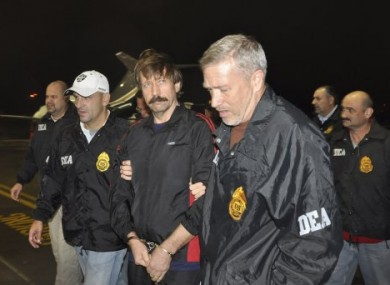 Viktor Bout, centre, flanked by DEA officials during his extradition last year.