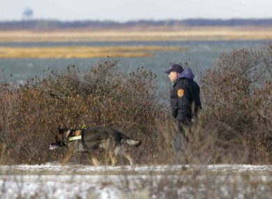 December 2010 photo of Long Island police searching the beach area where bodies were discovered.